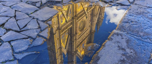 Reflection of the Orvieto cathedral in a water puddle, Umbria, Italy