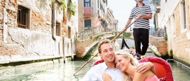Romantic honeymooners sailing in a Gondola in Venice, Italy